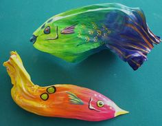 Tropical Fish on Exotic Palm Seed Pod Blue Hand by roseartworks
