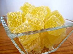 Lemon Jellies Yield: 3-4 dozen candies 2 1/2 TBS unflavored gelatin 1/4 cup water 3/4 cup fresh lemon juice 1 TBS lemon zest 2 cup granulated sugar 1/2 cup water 2 drops food coloring 1 to 2 cups sanding sugar, for coating (see note below)