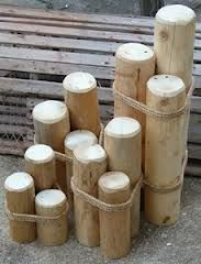 DIY beach pilings Lowes, a 6' round fence post, cut it to the sizes. A little rope and done!