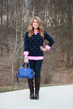 The J.Crew sparkling rhinestone sweatshirt is styled with a pink blouse, jeans, and boots for a fun and comfortable casual outfit