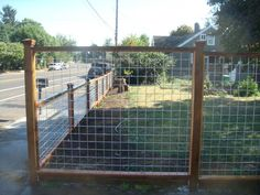 wood and galvanized mesh fence | ... /metal-fences/galvanized-
