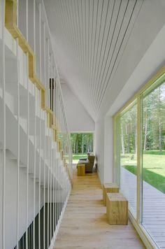 Aketuri Architektai clads woodland house in Lithuania with shale tiles