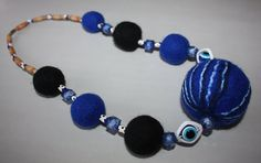 handmade felted necklace, felted jewelry, wool jewelry necklace, royal blue felted ball necklace, elegant exclusive unique necklace  THIS ITEM IS READY TO SHIP!  The necklace is decorated by Fatimas eye beads for good luck and to protect from evil!  * Material - 100% wool and plastic beads. Each felt ball is handmade. Metal clasp. * Color - Royal blue and black. The actual color may differ slightly from the one you see on your monitor screen, as it depends on the specific monitor settings…