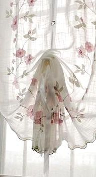 Rose strewn draped shade....sewn like a balloon shade only the gathering rings run up the middle for beautiful effect