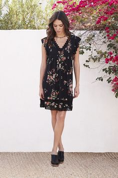 PALMA PINTUCK TUNIC. Sprinkled bouquets, eyelet lace trim and a pin-tuck bodice make this little black dress anything but basic. A double lace hem and ruffled cap sleeve take the Palma pintuck tunic over the top for a simple yet adorable dress you can wear anywhere. #johnnywas