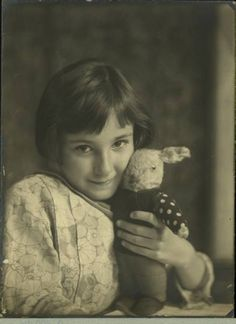 Girl with Rabbit Doll - E.O.Hoppe' (reminds me of The Miraculous Journey of Edward Tulane http://www.amazon.com/gp/product/0763647837?ie=UTF8&tag=sugshoandtaif-20&linkCode=xm2&camp=1789&creativeASIN=0763647837 )