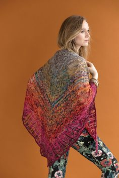 Bringing the modern spirit of summer to your wardrobe is the Departure Wrap designed by Anne Jones! With a reversible lace pattern and contrasting edges, this shawl packs a punch not only in its stitch pattern but in the bright, fun colors it uses! By using the array of shades available in the Koigu Pencil Box, you'll be the talk of the town! The large, triangular shape of this shawl gives it a multitude of ways to style it! Knitted Shawls, Crochet Shawl, Knit Crochet, Spirit Of Summer, Vogue Knitting, Wrap Pattern, Needles Sizes, Stitch Markers, Stitch Patterns