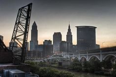 This was taken just after sunrise of the Cleveland, Ohio skyline with the Flats and the Cuyahoga River in the foreground and the Veteran's Memorial Bridge on the right. Cleveland Skyline, Cleveland Rocks, Cleveland Ohio, Cleveland Tattoo, Water Images, County Seat, Water Resources, Veterans Memorial, City Landscape