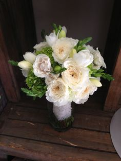 White garden roses with green hydrangea.  Bridal bouquet done by The Exotic Green Garden. www.exoticgreengarden.com