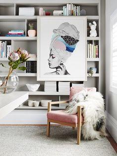 piece of art covering bookshelf