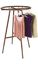 """Cobblestone Round Clothing Rack Features:    • Hand Brushed Copper Finish  • Wide 36"""" Diameter to Maximize Space  • Adjustable Push Button Legs  • Adjustable from 48"""" to 72""""  • Locking and Non Locking Casters Sold Separately (60109 and 60110)"""