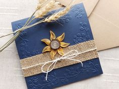 A beautiful dark blue burlap wedding invitation with quilling sunflower . I used a high quality cardstock , an elegant emboss. All the process is