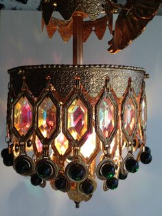 1967 Mid Century Art Deco Morrocan Revival Gold With Green and Irridecent Crystal Chandelier. $189,00, via Etsy.