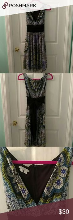 Beautiful blues and greens v-neck dress Great movement when you wear this dress! Ties in the back. Nice look for a night out! London Times Dresses Midi
