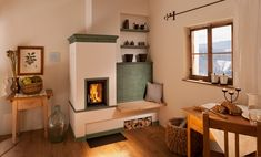 masonry stove , I want one similar to this in my house but with a longer bench and cooking facilities. Stove Fireplace, Rocket Stoves, Style Tile, Building A House, Sweet Home, New Homes, Construction, House Design, Home Decor