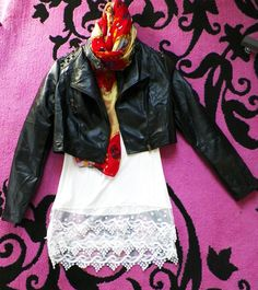 LAST ONE LEFT White tank top: $30.95 Black leather jacket: $63.95 Scarf: $18.95