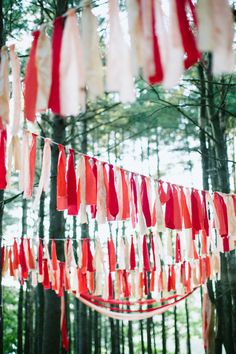 festive bunting in the trees Photography by summerstreetphotography.com, Event Design by makewellmade.com