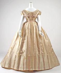 "Gold silk dress (front, evening bodice), French, ca. 1865. Label: ""Mme. Marguerite Robes, 6 rue de Miromenil, Paris"""