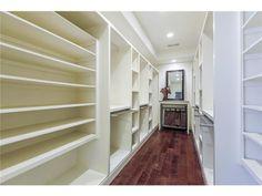 Walk in white closet // Beautiful custom cabinetry and storage