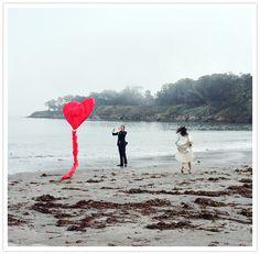 Heart shaped kite in wedding photos.