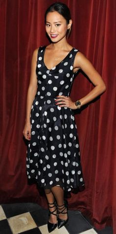 SEPTEMBER 14, 2013 Jamie Chung WHAT SHE WORE Chung looked pretty in a navy-and-white polka-dot Ann Taylor frock that she accessorized with a delicate necklace and strappy pumps.
