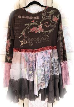 Rustic ,raw and romantic,,Altered Collage Tee/ Tunic ~ Bodice front has a Batik style design of a heart and various words including chocolate. Back of Bodice has Chocolate swirls and words.. Neckline is rustic cut with Raggedy Trim hand stitched on and front embellishment of a a white