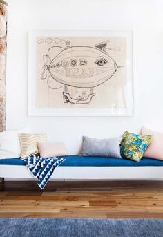 Want to inject some personality & style into your space? Try adding fun artwork and some great colored throw pillows.