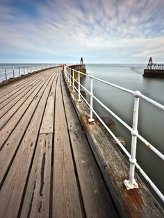 Whitby Piers by Michael James Combe