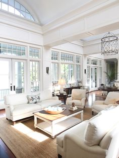 Great room door idea with windows above. Double sliding doors to create four panes of glass