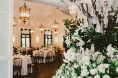 View of The Orangery at Jaspers with the Flower arrangement on the foyer table in the foreground