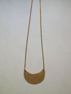 hand-carved brass necklace