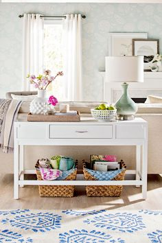 Use baskets to gather miscellaneous items that would otherwise clutter up your living room. Woven storage baskets can hold toys, games, books, movies, TV equipment, throw blankets, and more. #storage #basketstorageideas #livingroom #livingroomstorage #bhg Desk In Living Room, Living Room Storage, Living Spaces, Traditional Dining Tables, Small Apartment Decorating, Table Furniture, Geek Furniture, Antique Furniture, Furniture Ideas