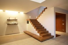 Ideas Nice Simple Design Of The Floating Basement Flooring Options That Has Grey Modern Floor And Also Wooden Stairs That Can Add The Beauty Inside The House Modern Nice Floating Basement Flooring Options