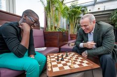 "Grandmaster Garry Kasparov was an inspiration to Ugandan chess phenom Phiona Mutesi. So how'd the 17-year-old do against him in a match at the fourth-annual Women in the World Summit?  Mutesi is from the slums of Katwe. Her father died of AIDS when she was 3 years old, and she began to play the game as a way to earn cups of porridge. In an interview she told The Daily Beast that she likes chess because ""It's about planning. If I wanted to survive, I had to plan."""
