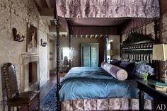 Martyn Lawrence Bullard Restores a Spectacular Medieval Castle in Italy. One guest suite has a Renaissance air, with a Schumacher damask covering the walls and a Scalamandré fabric used for the canopy and skirt of the Bullard-designed bed.