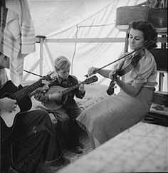 Dorothea Lange    Migrant     Family from Arkansas Playing Hillbilly Songs    1939