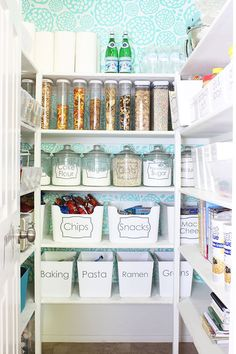 Don't hunt through mountains of cardboard boxes. Instead, take a few minutes to transfer ingredients and snacks into clear canisters so you can skip reading labels – and inspire a uniform tidiness. Plus, you'll keep mice away from your cookies and crackers. See more at Classy Clutter » - HouseBeautiful.com More