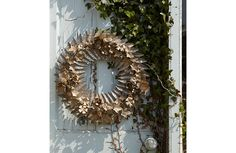 A beautiful alternative to a leafy Christmas wreath - distressed yet detailed metal-work always looks amazing...