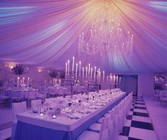 Previously set in a yellow glow, LED lights that have changed to a purple hue have transformed a room from classic to whimsical.