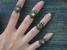knuckle ring CHOOSE ONE armor ring midi ring nail ring claw ring finger tip ring vampire goth victorian moon goddess pagan boho gypsy by gildedingypsy on Etsy https://www.etsy.com/listing/172170702/knuckle-ring-choose-one-armor-ring-midi