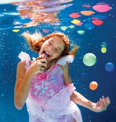Here\'s a gallery of Elena Kalis underwater photography, they look beautiful, especially the one eating ice-cream underwater. Underwater Photos, Underwater Photography, Elena Kalis, Natural Models, Eating Ice Cream, New Year Celebration, Summer Parties, In Kindergarten, Holidays And Events