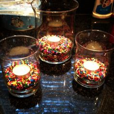 Sprinkles as a vase filler | cheap, easy and fun way to decorate a table! **Do this in either pink or gold sprinkles***  Fantastic compliment to the glitter candle holders