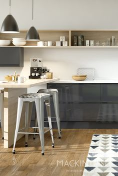 Modern handle less Mackintosh kitchen in Anthracite with open shelving and breakfast bar area. For more examples, please visit http://www.mackintoshkitchens.co.uk/kitchens