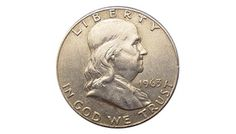 """Benjamin Franklin Silver Half Dollar - Approximately 510 million Franklin halves were minted during 1948 to 1963. Coins without a mintmark were minted in Philadelphia, whereas those with a """"D"""" were minted in Denver and with an """"S"""" in San Francisco. The mintmark on specimens having one is visible on the reverse side centered above the bell yoke. Large quantities of this coin were melted as silver bullion shortly after 1964, when the intrinsic value exceeded the face value of U.S. silver…"""