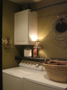 Add a ledge above the washer/dryer to keep things from finding their way back there!  Also love the cabinets and hanging bar to dry things