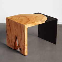An ash single-fold with a black steel fold leg. We salvaged this tree in Seattle.