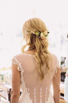 Pulled-back with a Flower Adornment: http://www.stylemepretty.com/2015/05/13/20-ways-to-rock-long-hair-at-your-wedding/