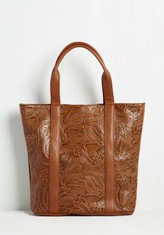 Distinctly Arts District Bag. Commuting downtown with this warm brown tote in tow, onlookers know exactly where you hail from! #brown #modcloth