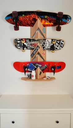 Skateboards on the floor are a legitimate safety hazard: shelf them (it's safer, plus it shows off the deck artwork).