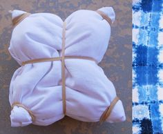 This week I decided to try Shibori dying some fabric scraps. If you don't know what Shibori dying is, it is a Japanese form of dying clot. Shibori Fabric, Shibori Tie Dye, Fabric Yarn, Fabric Scraps, Dyeing Fabric, Fabric Dyeing Techniques, Tie Dye Techniques, How To Tie Dye, How To Dye Fabric